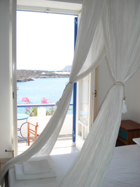 A bedroom with beautiful sea view